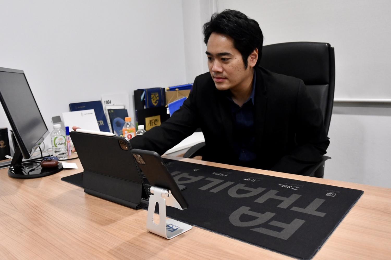FAT secretary general Patit Supaphong attends a meeting.