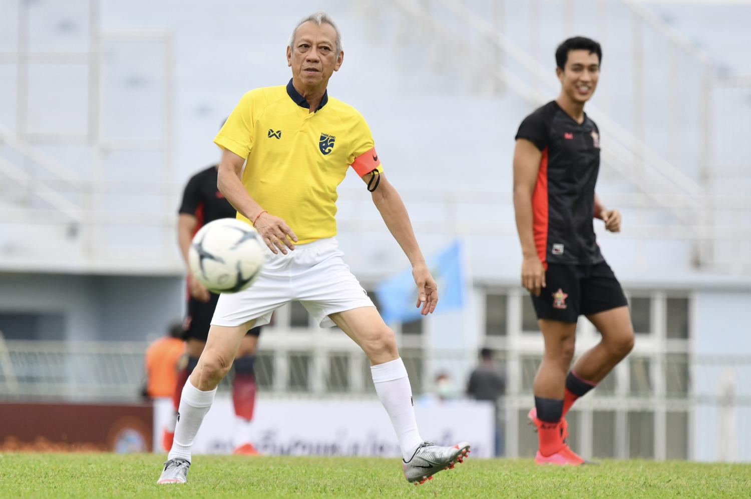 Rayong Kick Off!: Phiphat Ratchakitprakarn, the tourism and sports minister, in action during the exhibition match.