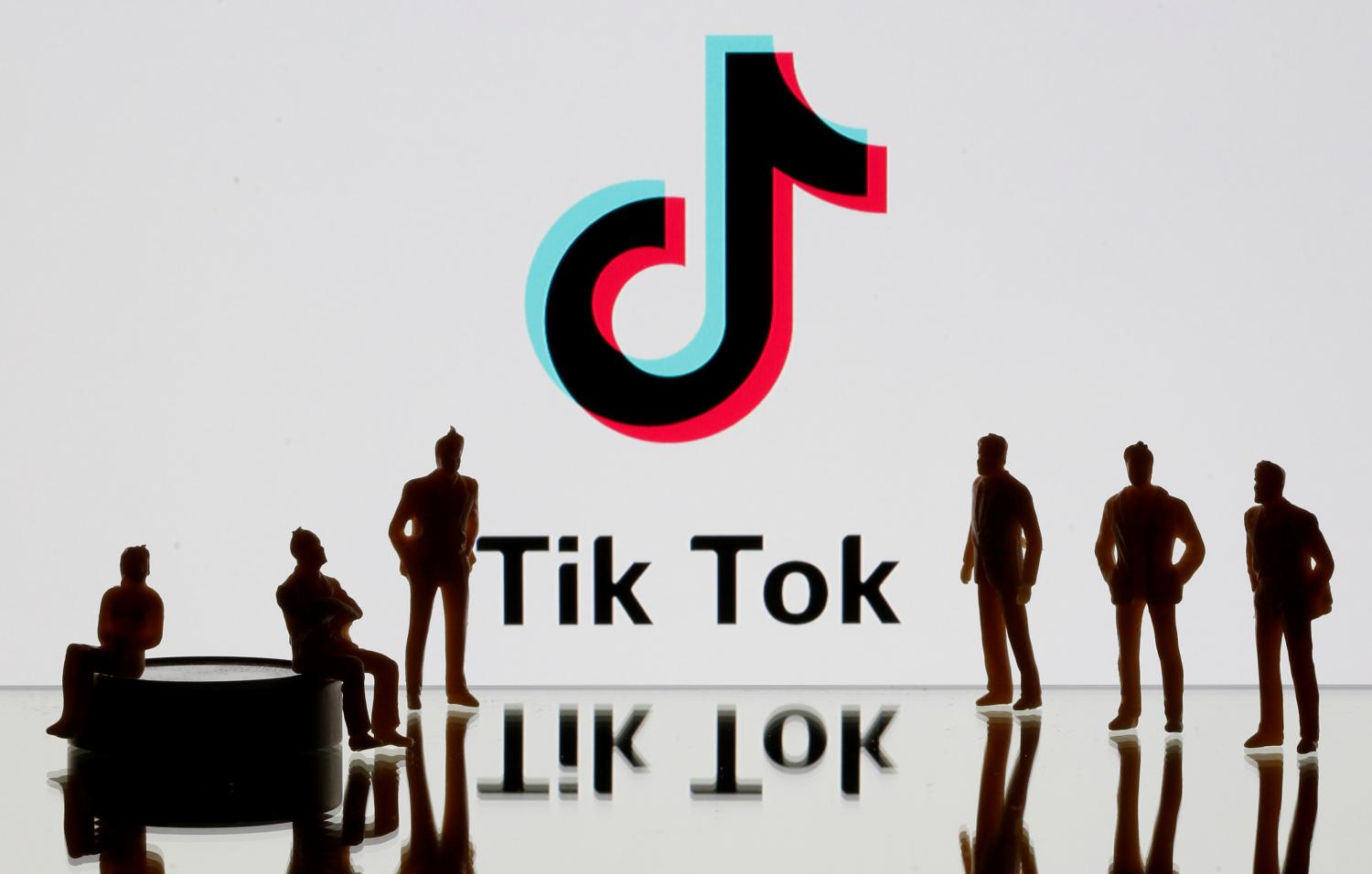 3-D printed figures are seen in front of a displayed TikTok logo in this picture from last November.(Reuters photo)