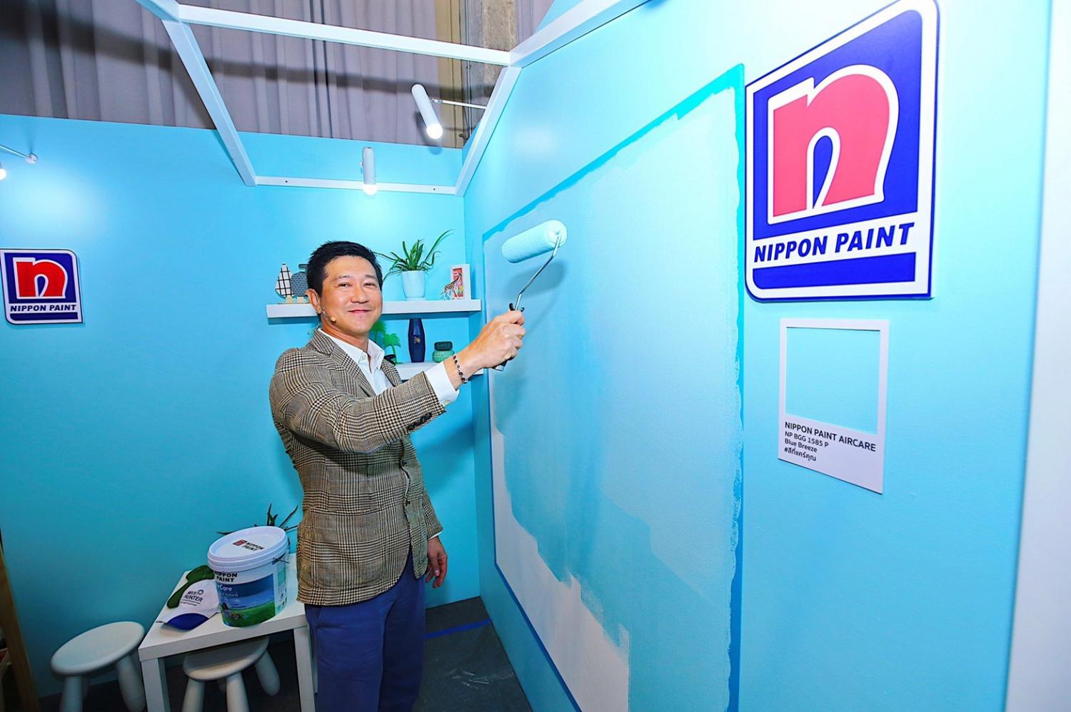 Mr Watchara promotes a new line of paint that purports to be antibacterial and antiviral.