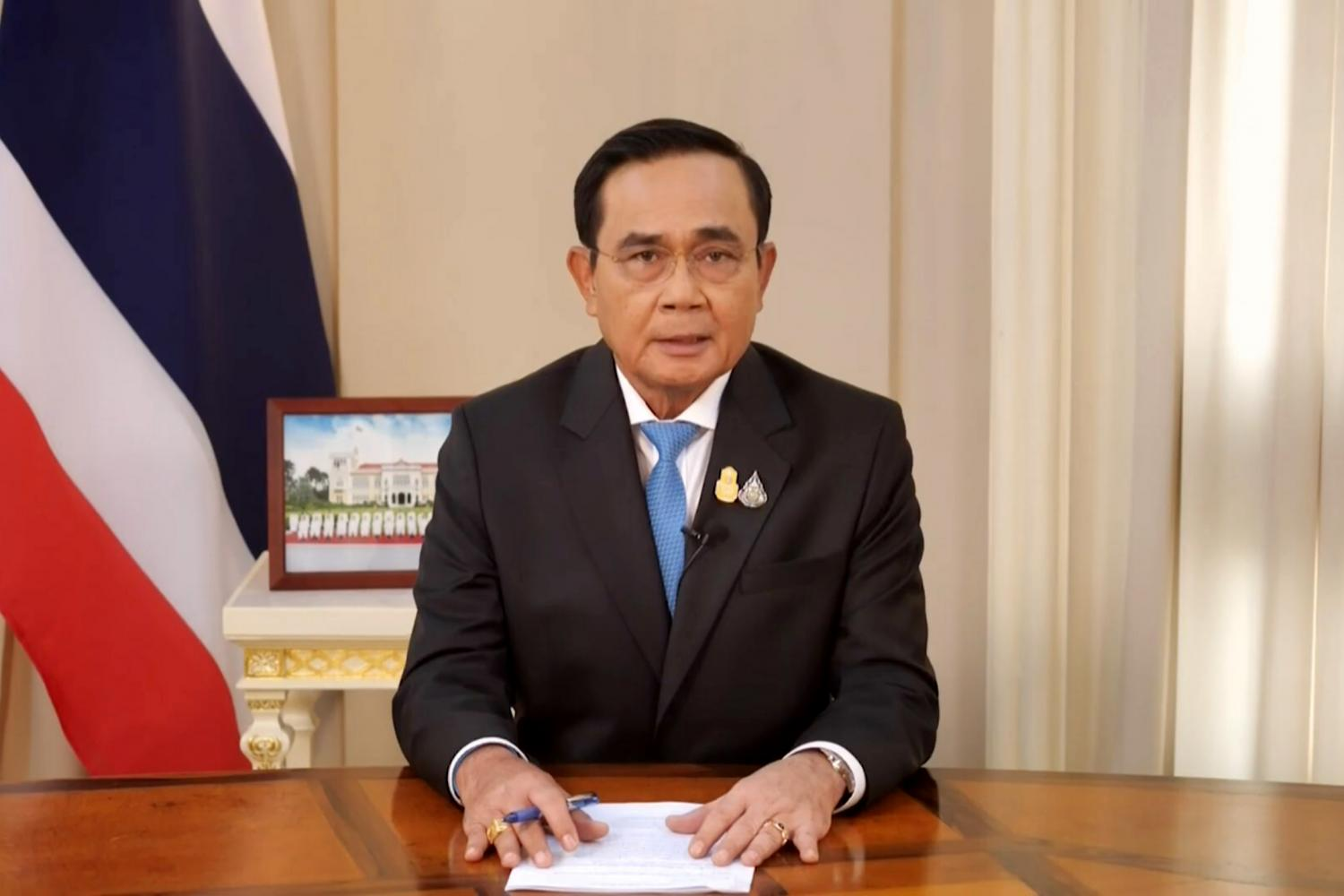 Prime Minister Prayut Chan-o-cha delivers a televised speech urging national unity and outlining various tasks the government will pursue following the latest cabinet reshuffle. The new cabinet held its first meeting on Thursday.(TV Pool photo)