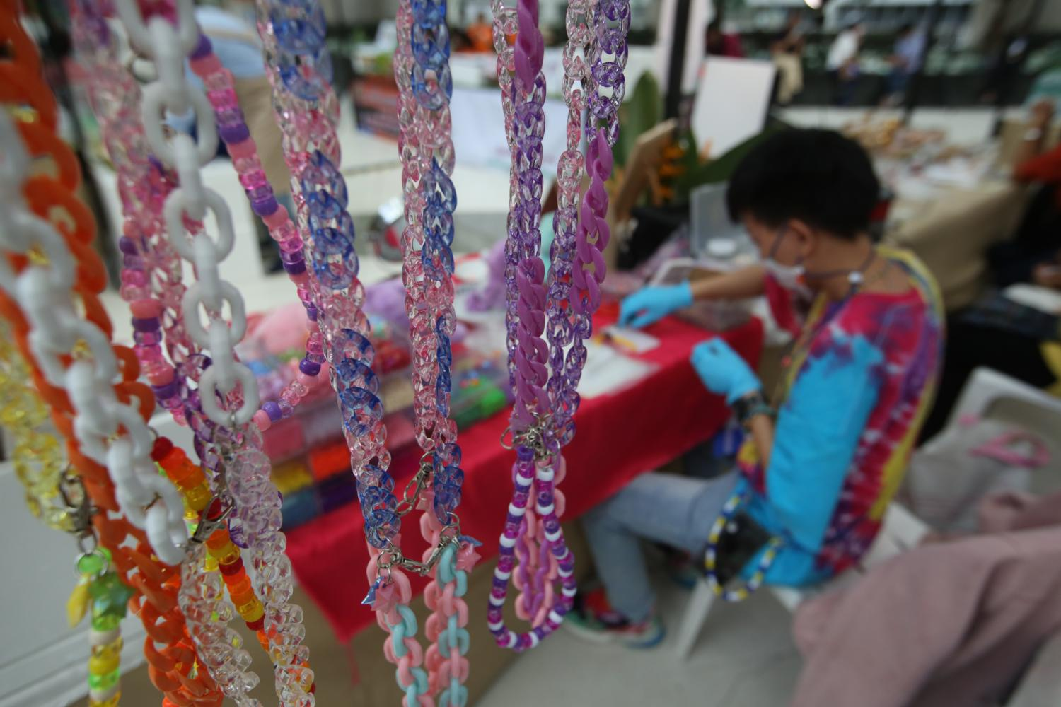 Handmade beads on display at the SME Market Fair in Nonthaburi province on Aug 6. The ratio of TCG-backed loan guarantees for SMEs rose by 167% in the first seven months of 2020.(Photo by Arnun Chonmahatrakool)