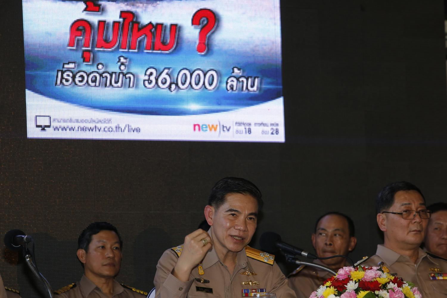 In this 2017 file photo, Adm Luechai Ruddit, then Navy chief of staff, middle, chairman of the navy's submarine procurement management panel, addresses a press conference to defend the controversial submarine purchase.Bangkok Post