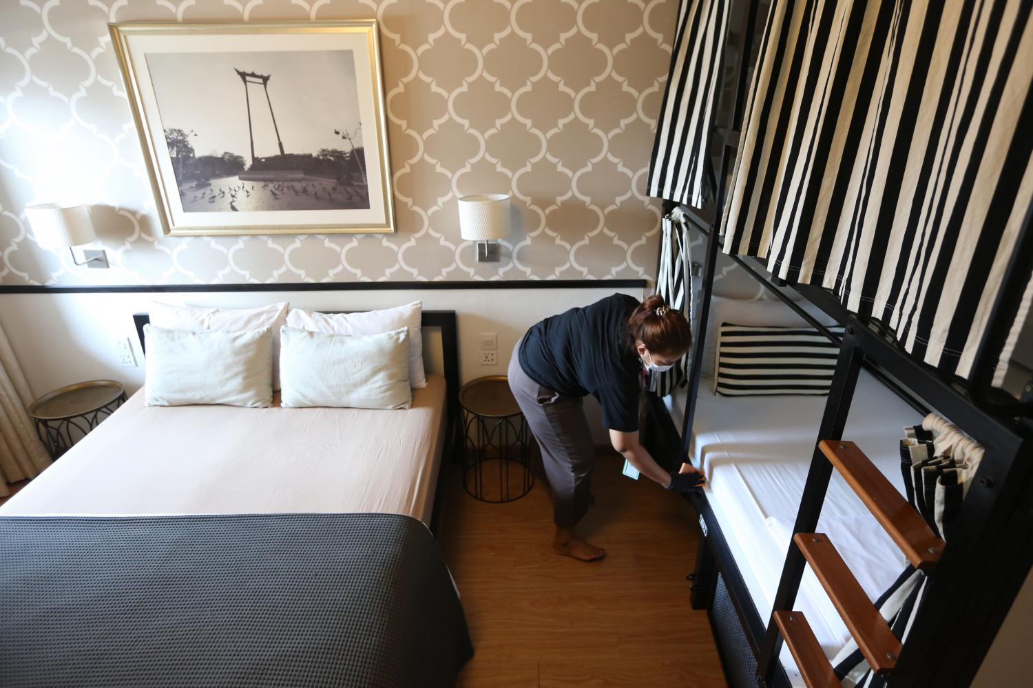 A cleaner disinfects a hotel room in central Bangkok. WICHAN CHAROENKIATPAKUL