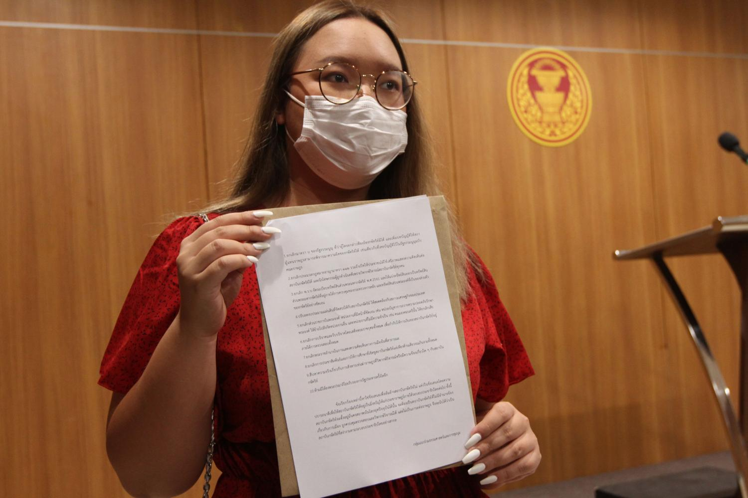 Activist Panasaya Sitthijirawattanakul with the document she submitted. (Photo by   Wichan Charoenkiatpakul)