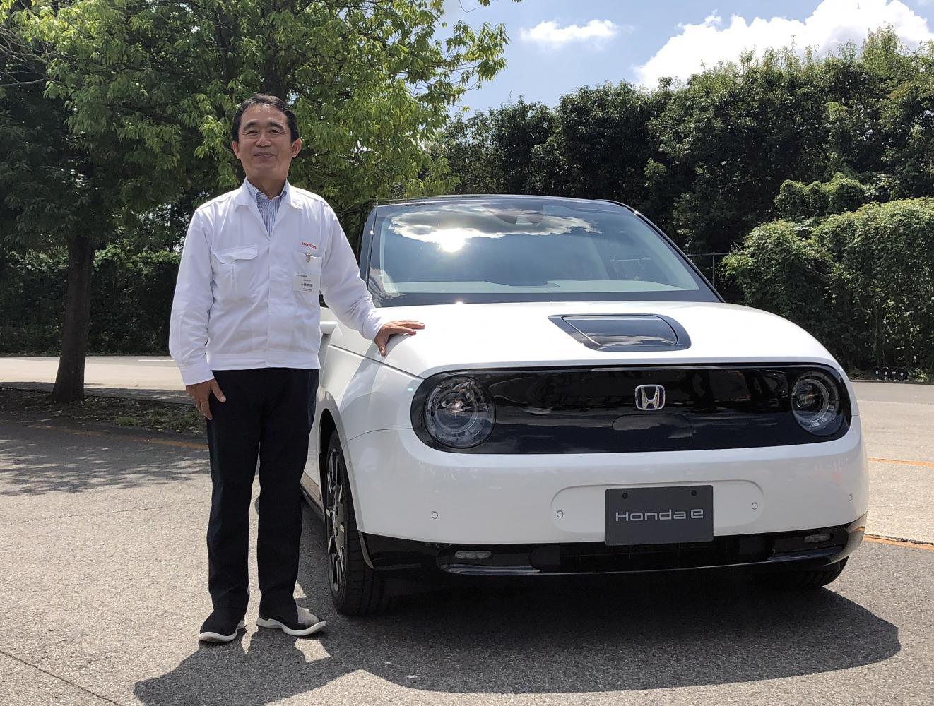 Senior chief engineer Tomofumi Ichinose poses for a photo next to a Honda e electric car.(Reuters photo)