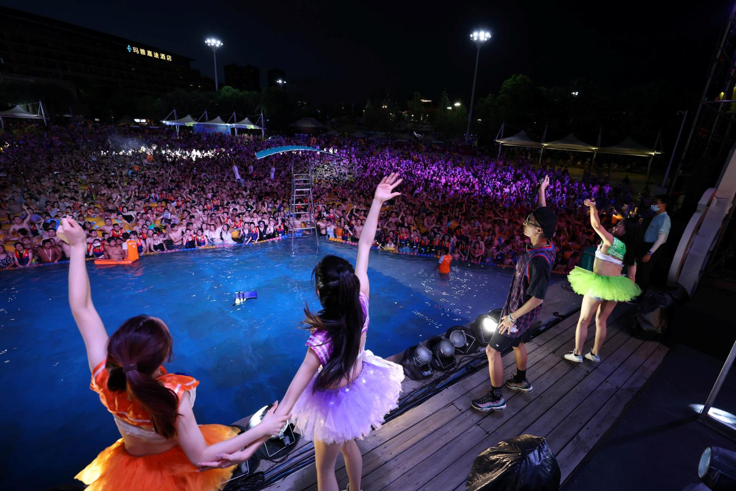 A crowd watch a performance at the Wuhan Maya Beach Park on Aug 15. REUTERS