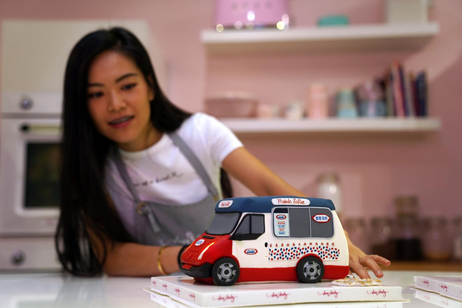 Alison Chan, co-owner of Dear Harley Cake Studio, shows one of the illusion cakes.(Reuters photo)