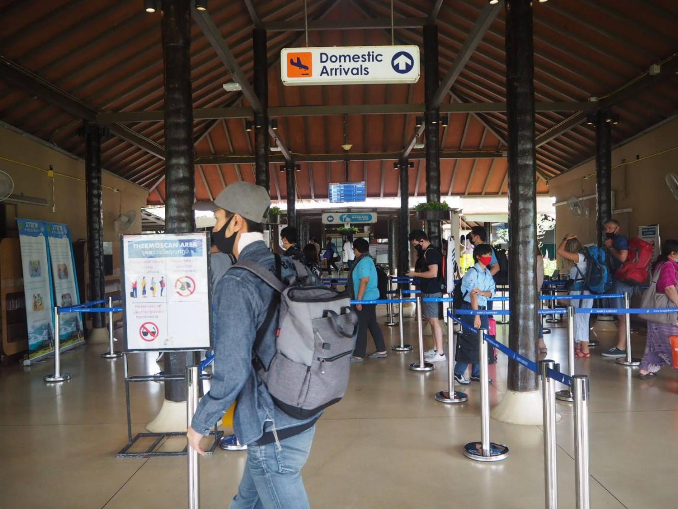 Health screening procedures and thermal scans are mandatory for tourists upon arrival at Samui airport following the outbreak. Dusida Worrachaddejchai