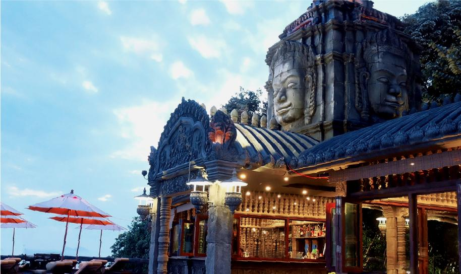 A picture of a restaurant on the website of the Le Palais Hotel in Koh Phangan shows its 'Bayon Restaurant' which features a touch of Khmer and European culture in the design of the hotel. Le Palais Hotel