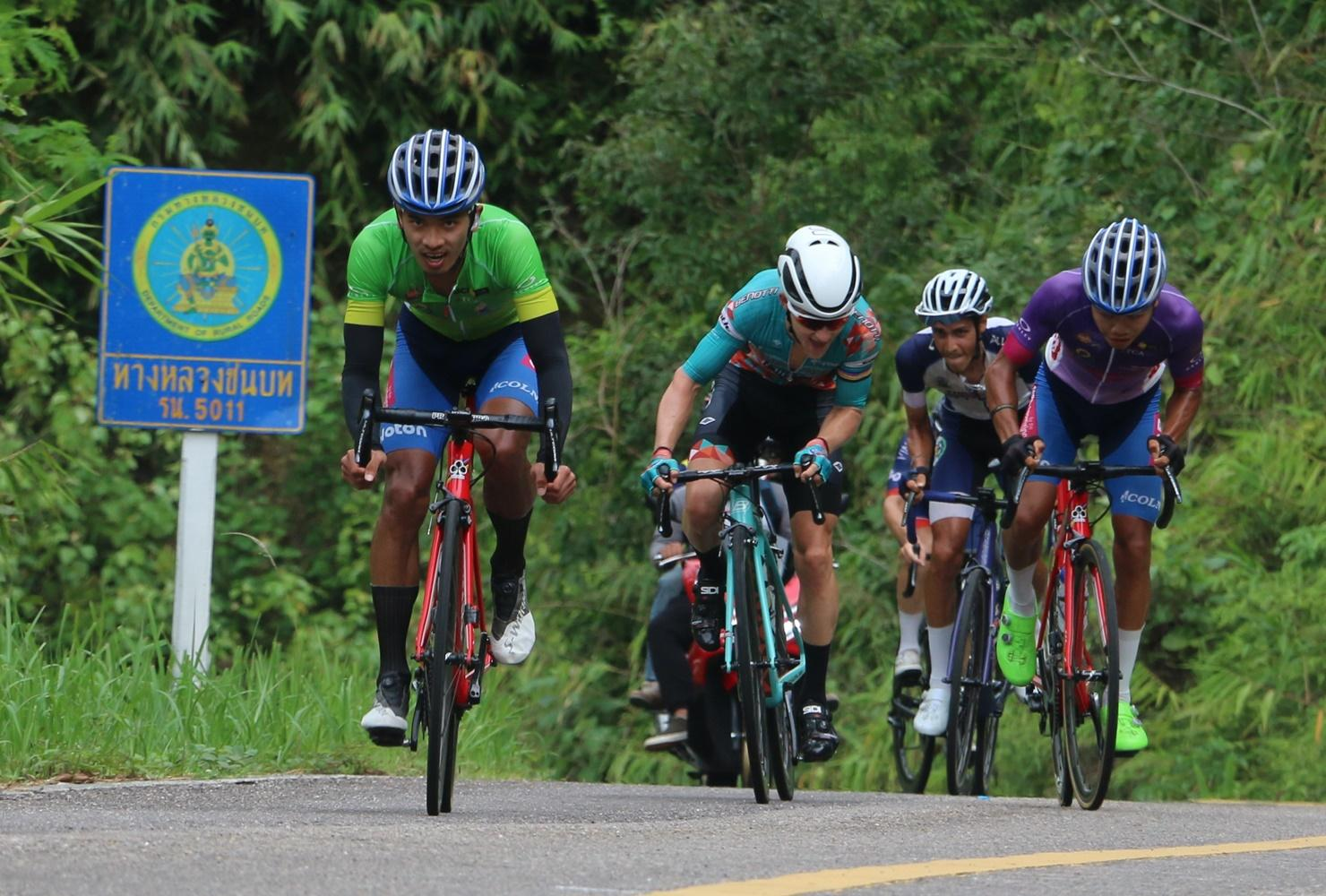 Thai rider Sarawut Sirironnachai, left, competes in the fourth stage of the Tour of Thailand on Friday.