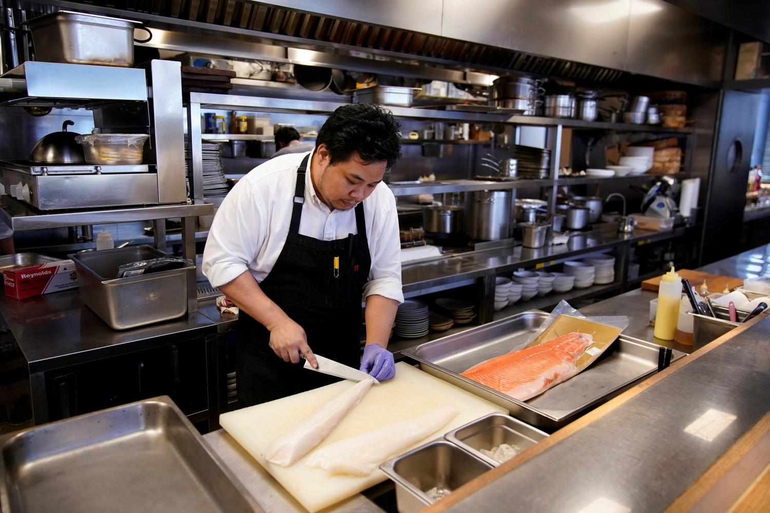 Chef and owner Austin Hu prepares frozen cod fish and salmon at Heritage by Madison restaurant in Shanghai.