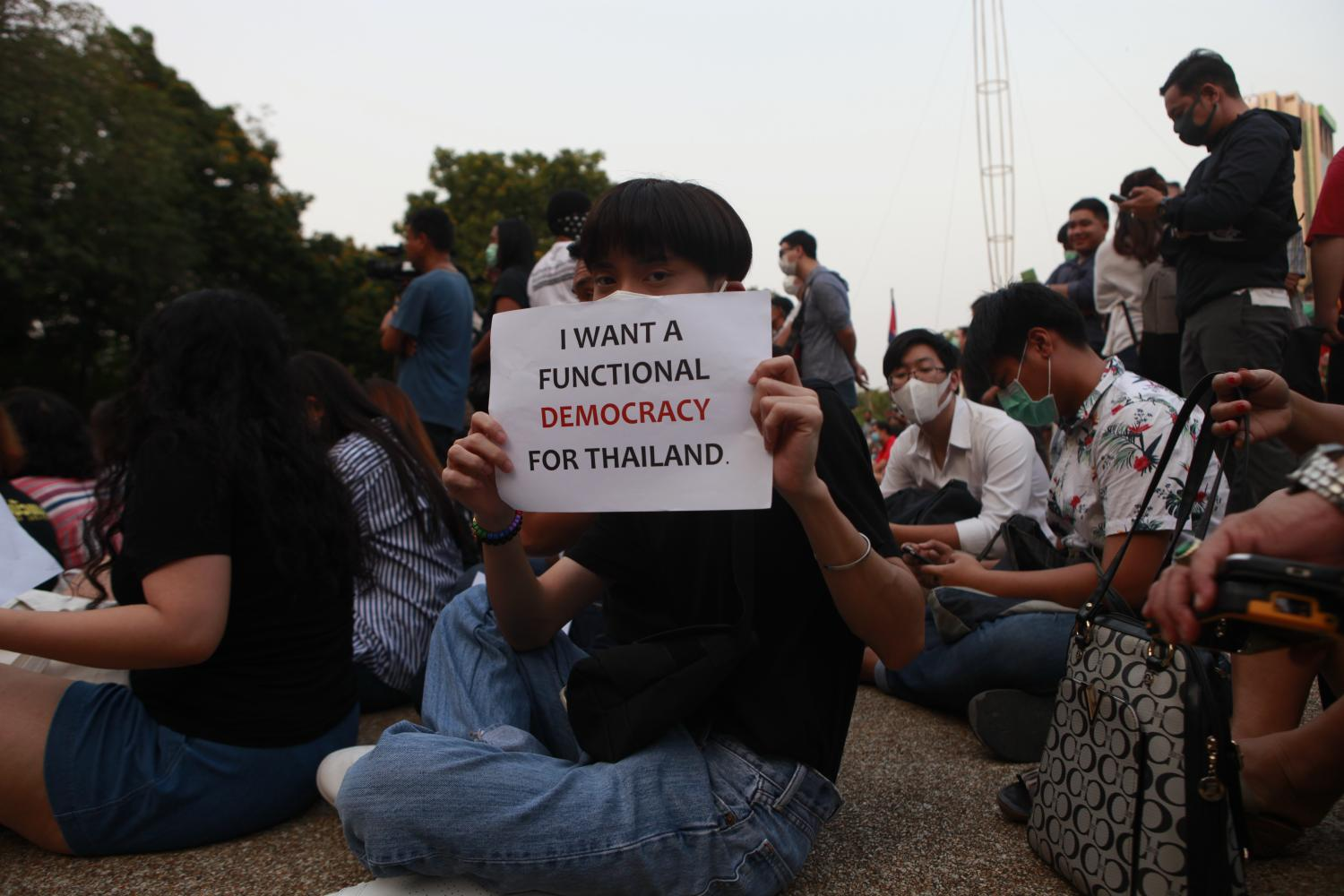 In this Feb 29 file photo, a student raises a pro-democracy placard during a rally at Kasetsart University. Nutthawat Wicheanbut