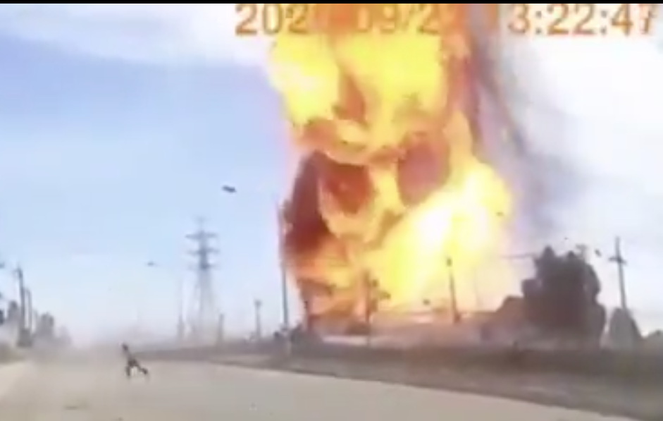 A person is seen running away from a huge fire. The scene was captured by an on-dash mounted camera.(Photo by Ton Prakan)
