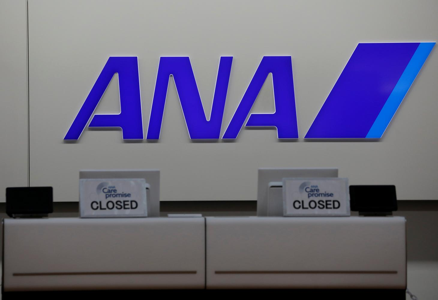 The logo of All Nippon Airways (ANA) is seen on its counter at a terminal of Haneda Airport. (Reuters photo)