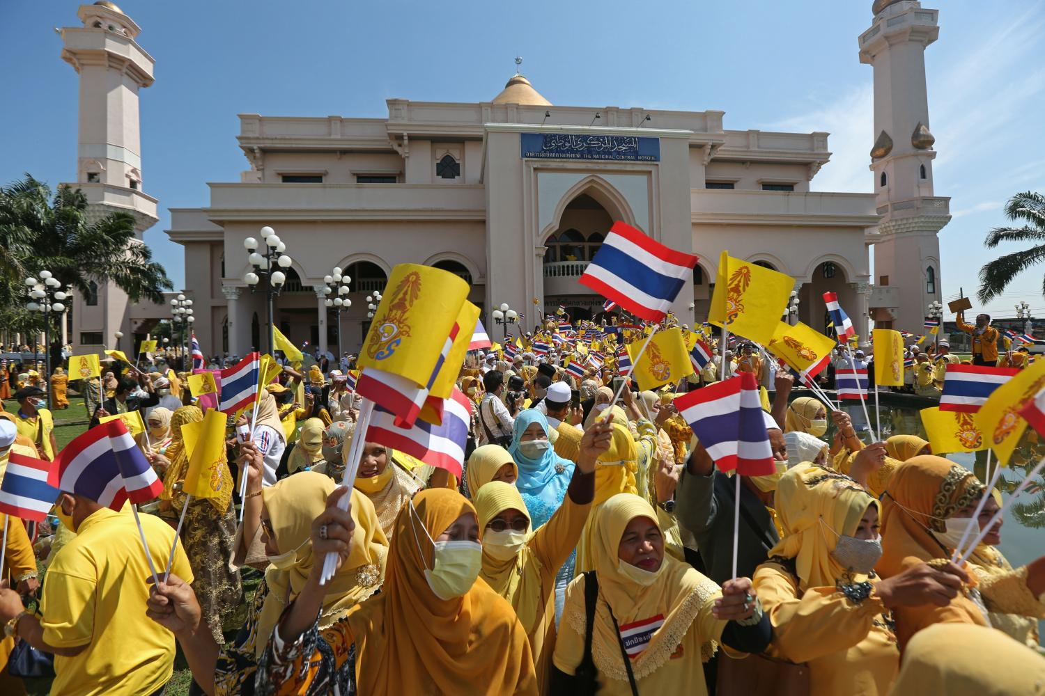 Yellow-clad Muslim residents wave national and royal flags in a show of support for the monarchy and national unity at the National Administration Centre for Islamic Affairs Chalerm Phrakiat in the Nong Chok district of Bangkok yesterday.Varuth Hirunyatheb