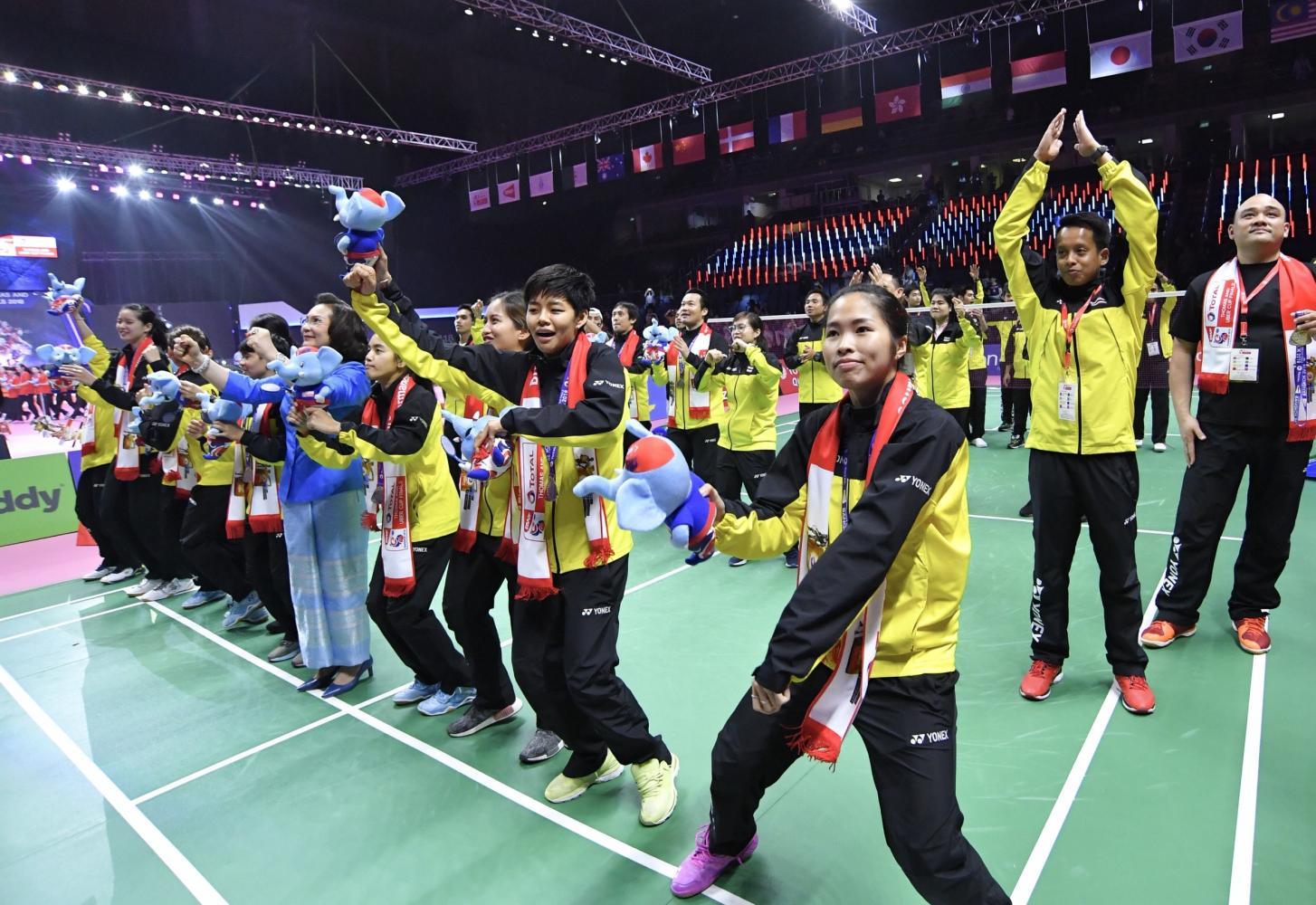 Thai players celebrate finishing second in the Uber Cup.