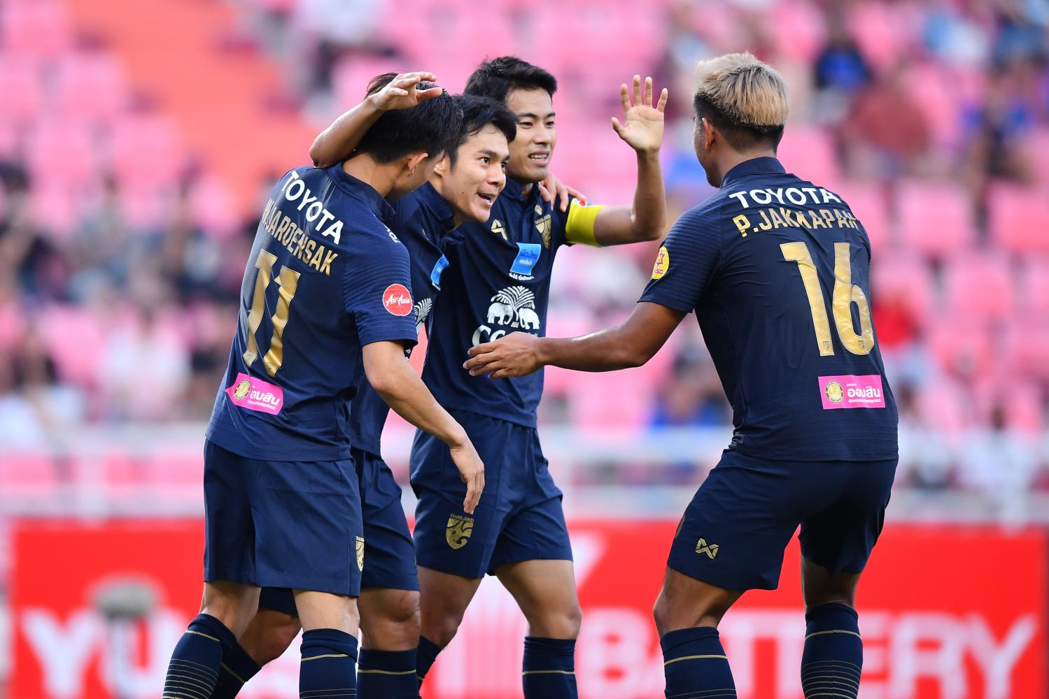 On target: Thailand's Panupong Polsa (second left) is congratulated by teammates after scoring against Thai League All-Stars on Saturday.
