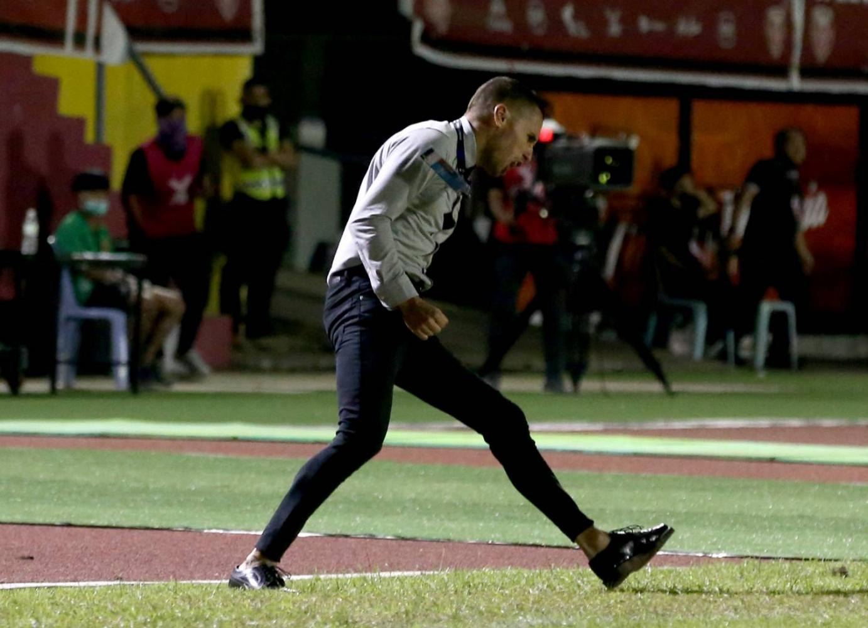 Muang Thong coach Mario Gjurovski reacts after a win.