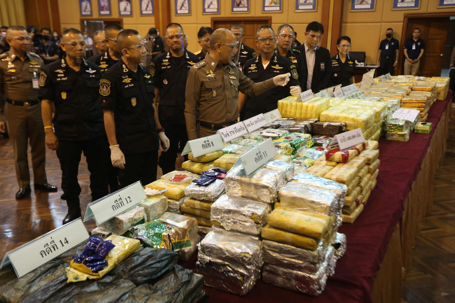Narcotics police display large hauls of drugs, including millions of speed, over 800kg of crystal meth and ketamine, seized in various raids. (Photo by Varuth Hirunyatheb)