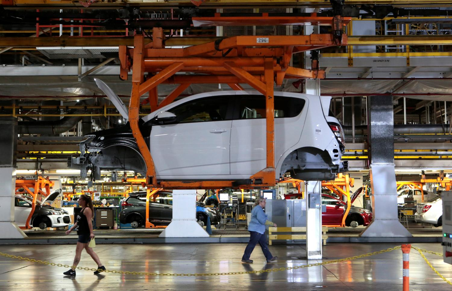 A partially assembled 2017 Chevrolet Bolt EV is on the assembly line at GM's assembly plant in Orion. The company said it would spend $27 billion through 2025 to develop EVs and driverless vehicles.