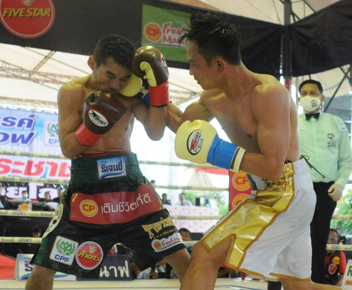 Stunning blow: Panya Pradabsri (right) punches Wanheng Menayothin during their fight in Nakhon Sawan on Friday.