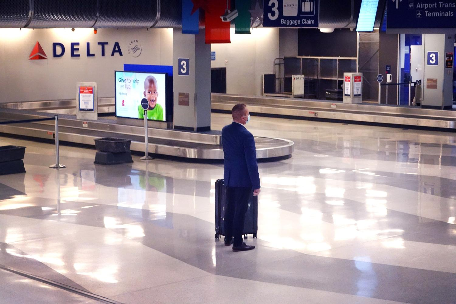 Baggage claims like this lonely one at O'Hare International Airport in Chicago will be busier post-pandemic, but it will take years to return to the level of business that airlines enjoyed in 2019. Some company trips are likely to be replaced by technology and never return.(Photo: Getty Images/AFP)