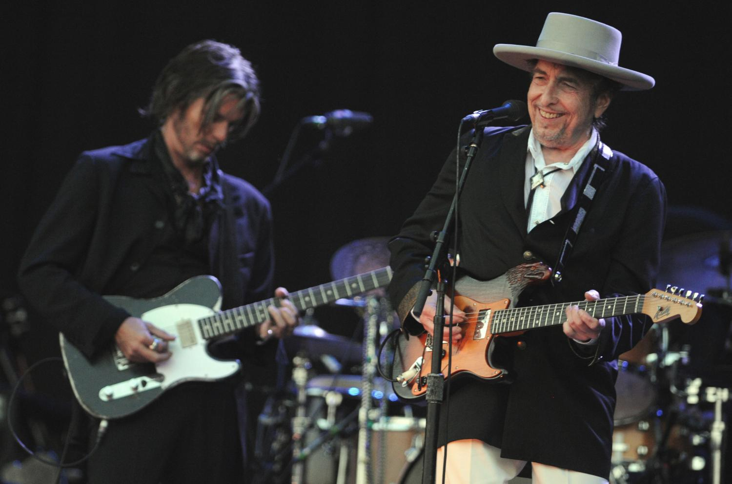 Bob Dylan, right, has sold more than 125 million records globally.(Photo: AFP)