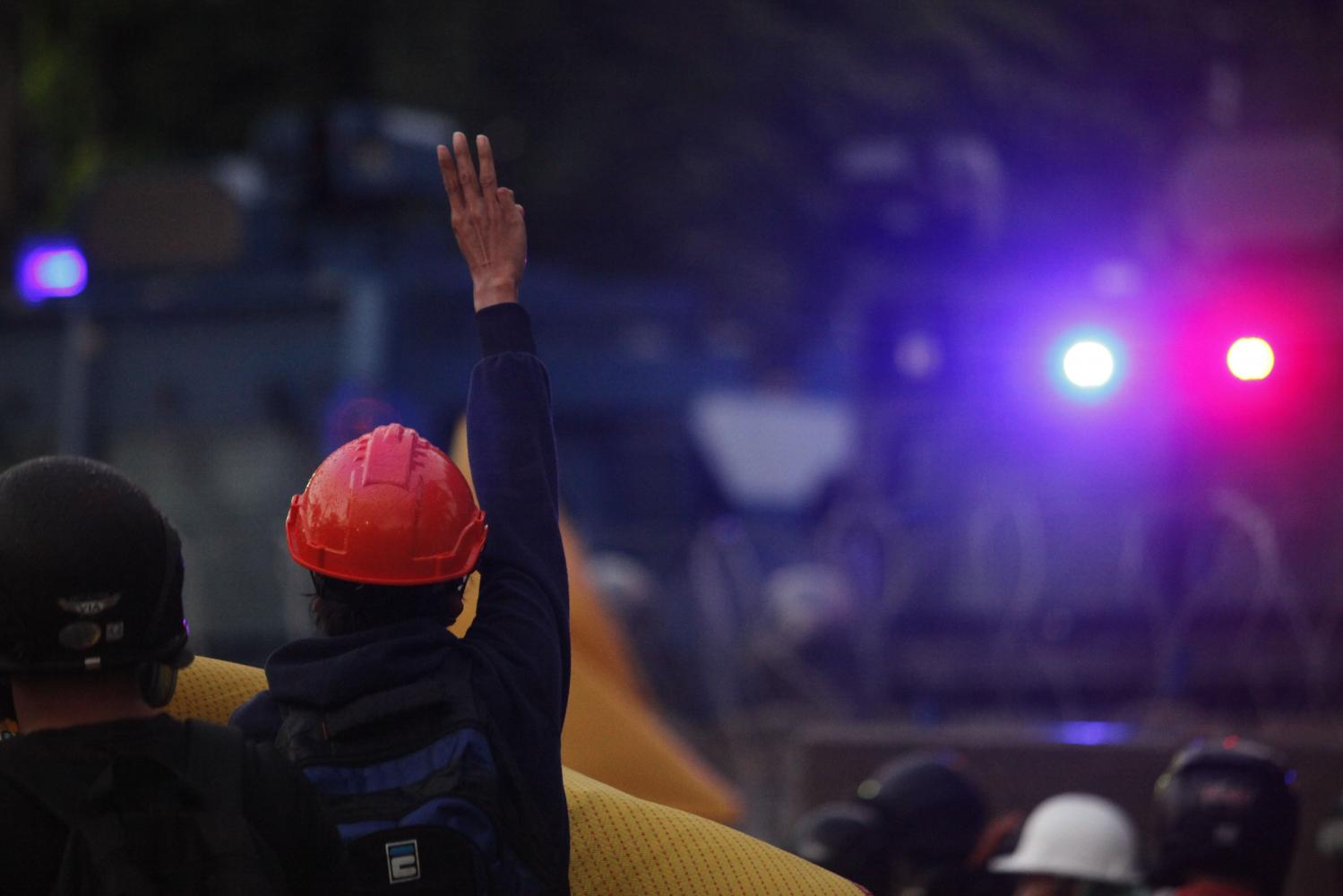 In this Nov 17 photo, a group of anti-government demonstrators clashes with riot police near the parliament building as a debate on charter rewrite is under way.Wichan Charoenkiatpakul