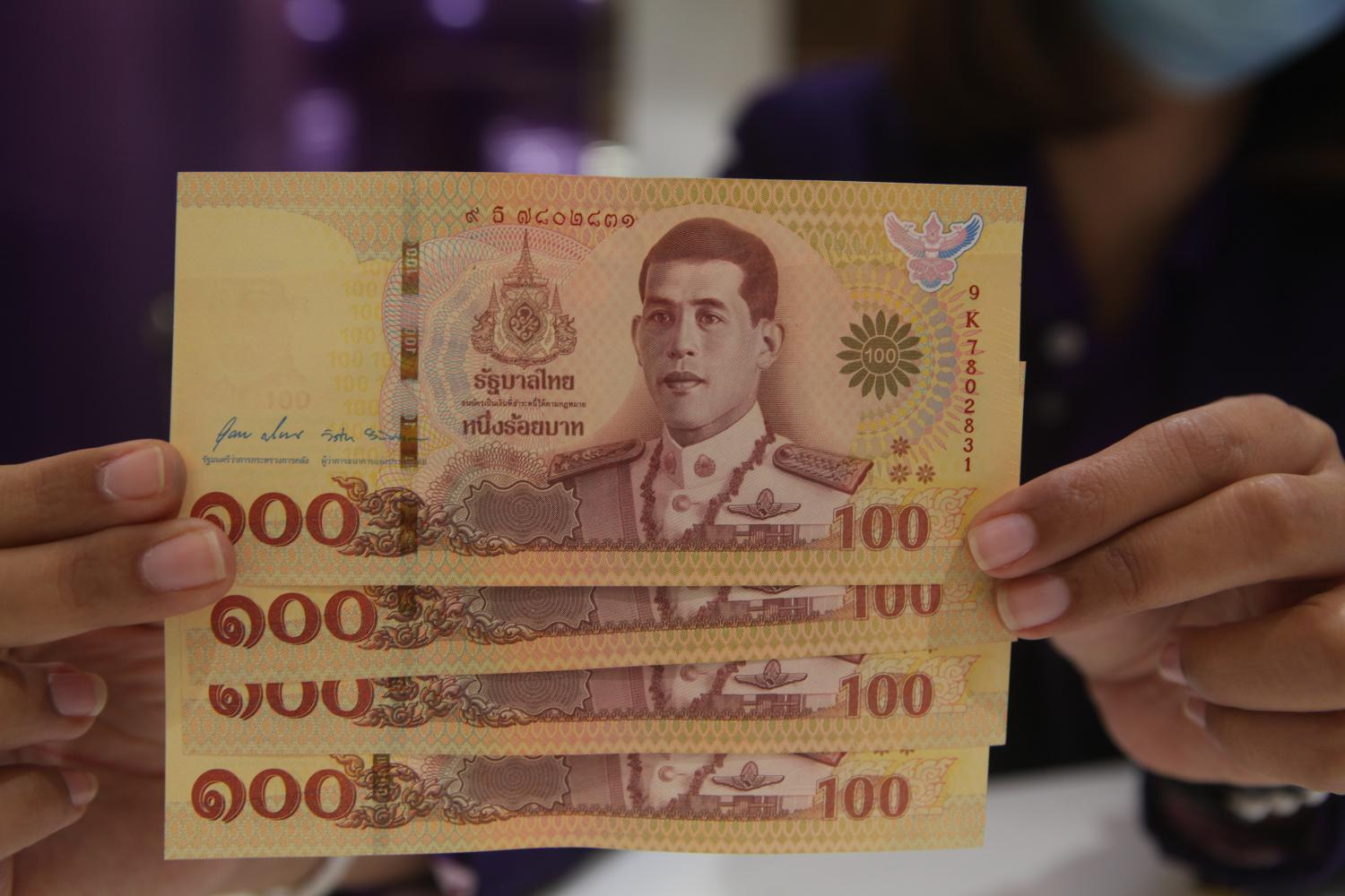 THE COLOUR OF MONEY: Commemorative banknotes marking the Royal Coronation Ceremony of 2019 make their debut on Saturday. The set comprises 1,000-baht and 100-baht notes.