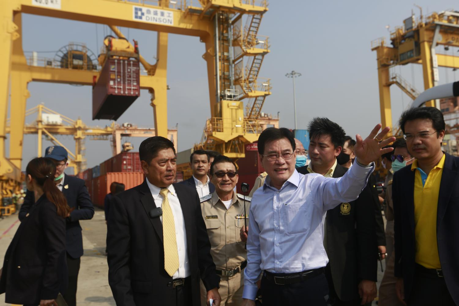 Mr Jurin gestures during his visit to Bangkok Port in Klong Toey. The government has vowed to subsidise part of the import fees for empty and used containers as part of its efforts to alleviate the container shortage. Arnun Chonmahatrakool