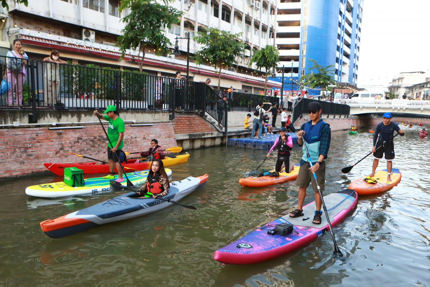 People go kayaking and paddleboarding in Klong Ong Ang. The historic canal in central Bangkok has been cleaned and its banks landscaped to attract visitors. Somchai Poomlard