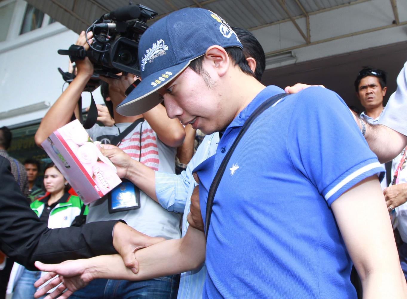 Red Bull scion, Vorayuth Yoovidhya, is brought for a blood test during police investigation into the hit-and-run case in 2012.
