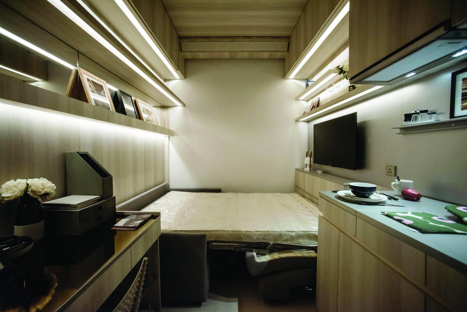 A sofa bed is unfolded inside a Seven Victory Avenue micro-apartment show home, developed by Henderson Land Development Co Ltd in Hong Kong.(Bloomberg photo)