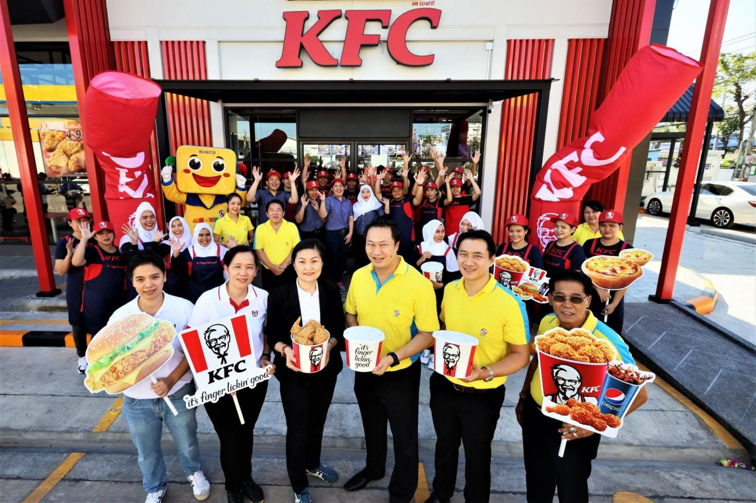 Mr Chairit, centre, says Susco plans to add four KFC outlets at its petrol stations this year.