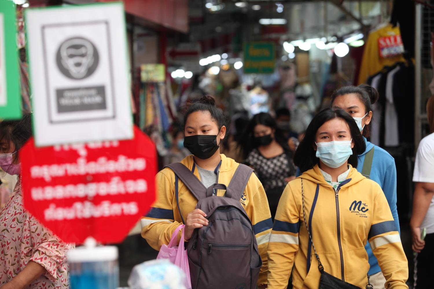 People wear face masks to prevent the spread of Covid-19 at Pratunam market following a recent outbreak. (Photo by Apichart Jinakul)