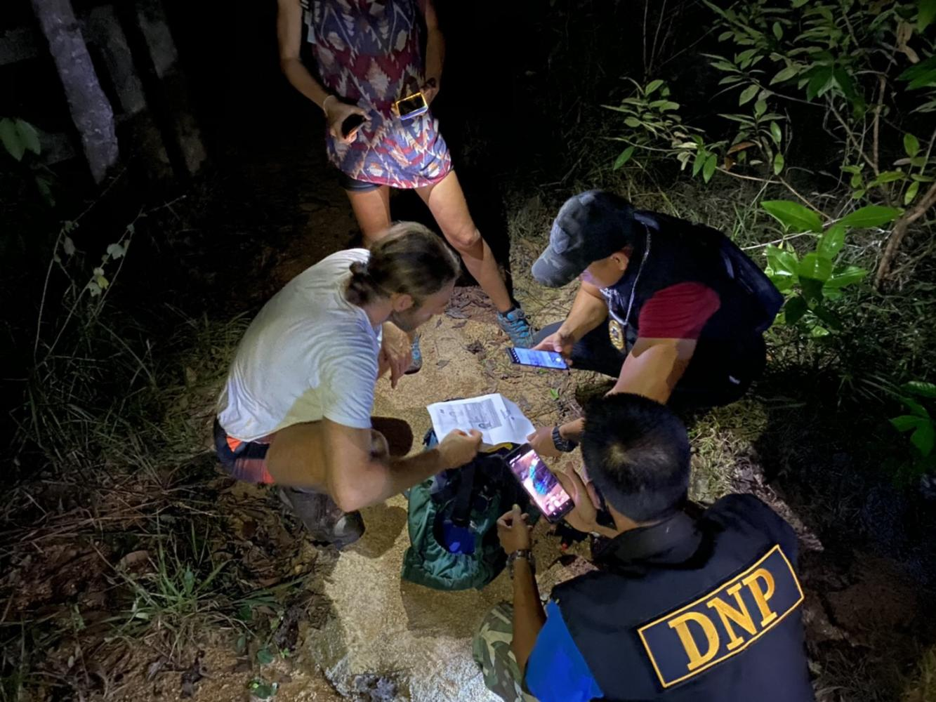 Rescuers find the Spanish couple lost in a forest on Koh Phangan.Dept of National Parks photo