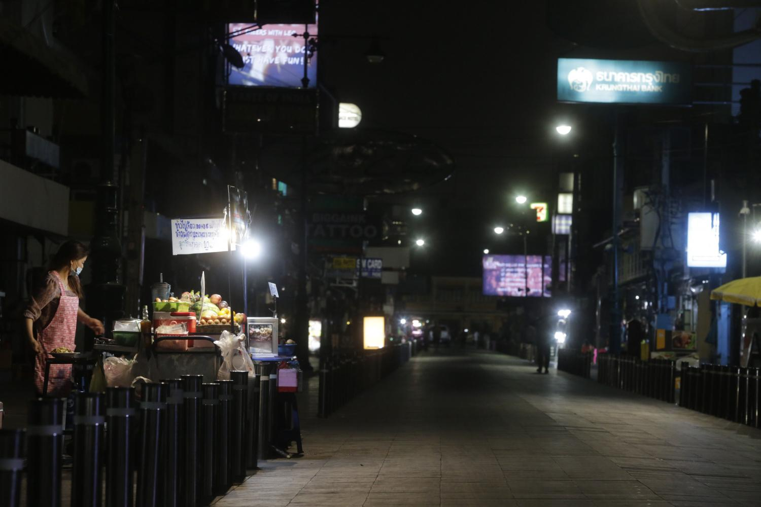Empty streets and food stalls near Khao San Road after the recent surge in Covid-19 cases. Pornprom Satrabhaya