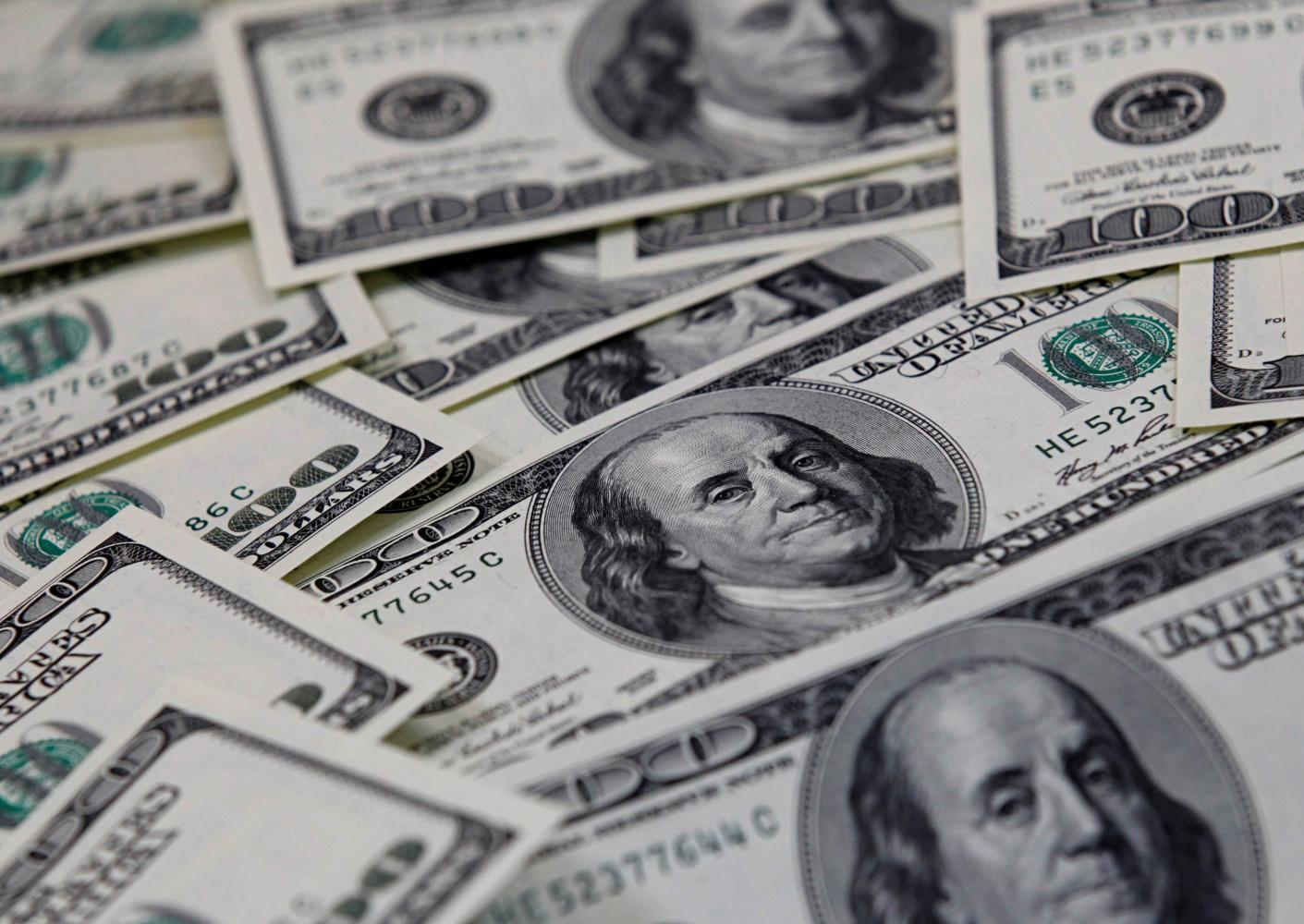Fresh stimulus spending under President Biden could weigh on the dollar, many investors say.reuters