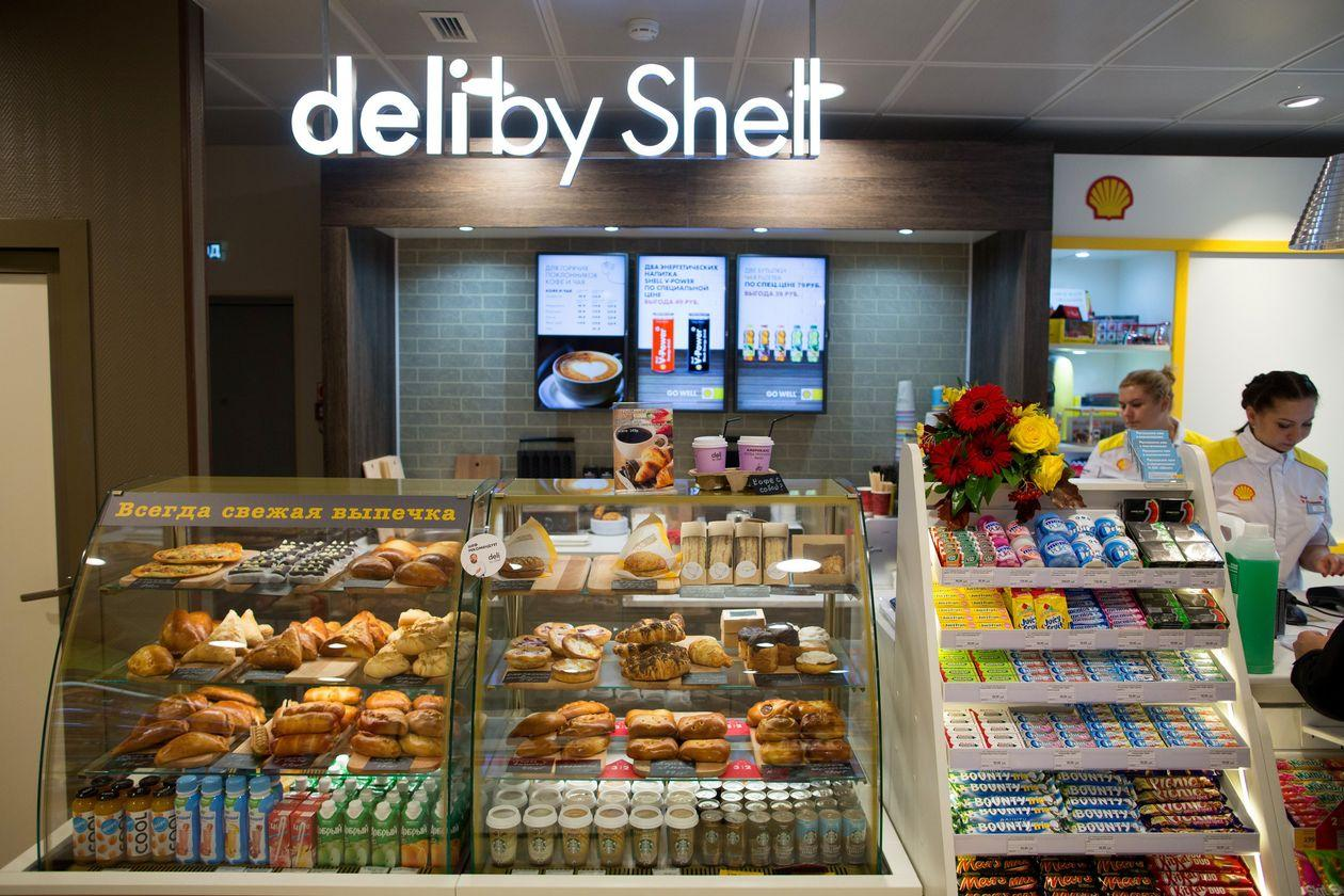 Customers are served in a 'Deli by Shell' store in Kemerovo, Russia. BLOOMBERG