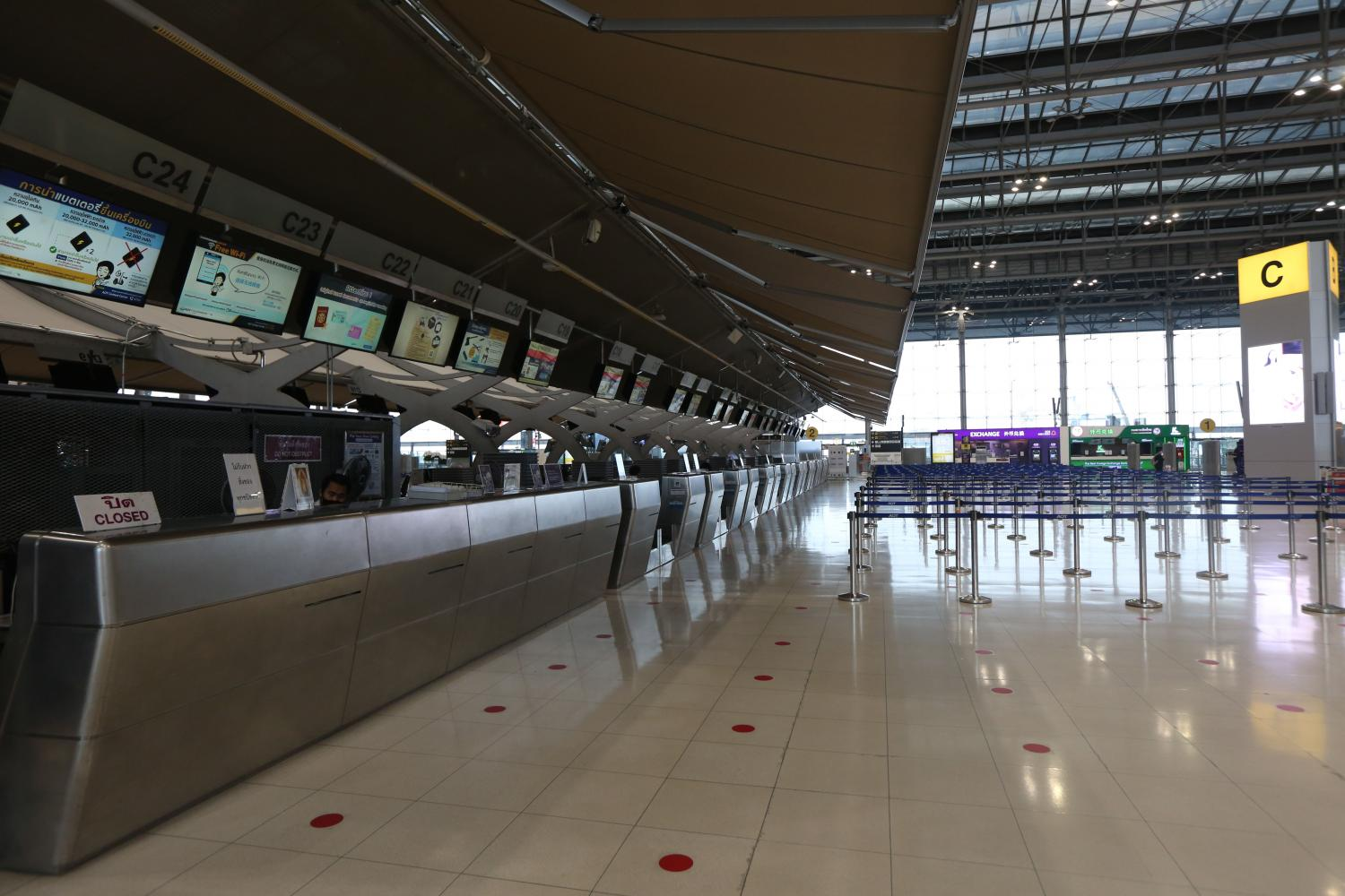 Suvarnabhumi airport is nearly empty amid the Covid-19 pandemic. Tour business operators have faced difficulties for nearly a year due to the international travel restrictions.(Photo by Varuth Hirunyatheb)
