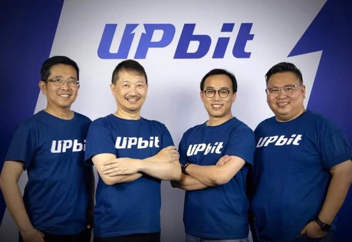 Peeradej Tanruangporn, centre right, chief executive of Upbit Thailand, with Mr Somphote, left, Mr Chatchaval, centre left, and Mr Preecha, right.