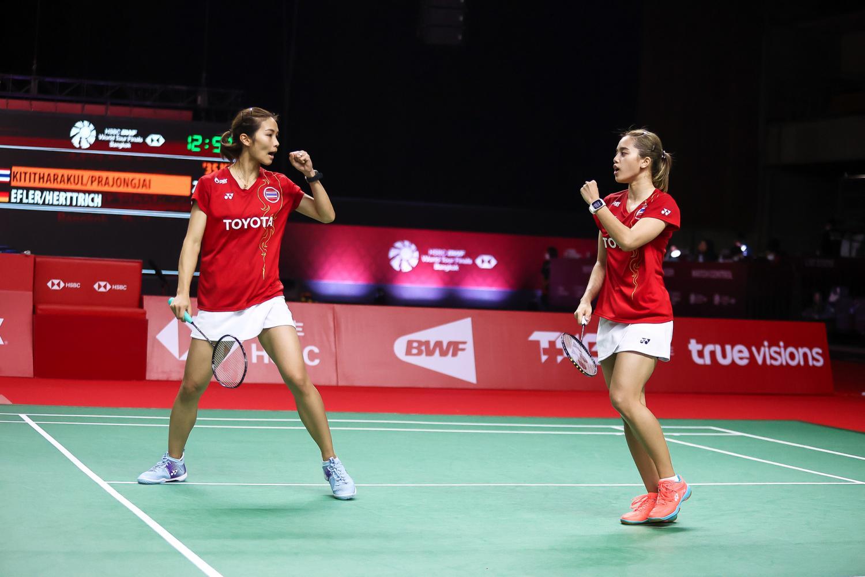 Thai women's doubles pair Jongkolphan Kititharakul, left, and Rawinda Prajongjai react during their match against Linda Elfer and Isabel Herttrich of Germany at Muang Thong Thani on Friay.