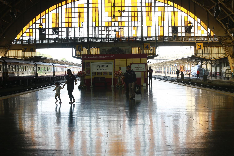 All quiet on the platform: People at Hua Lamphong Station, the main railway station in Bangkok. (Photo by Somchai Poomlard)