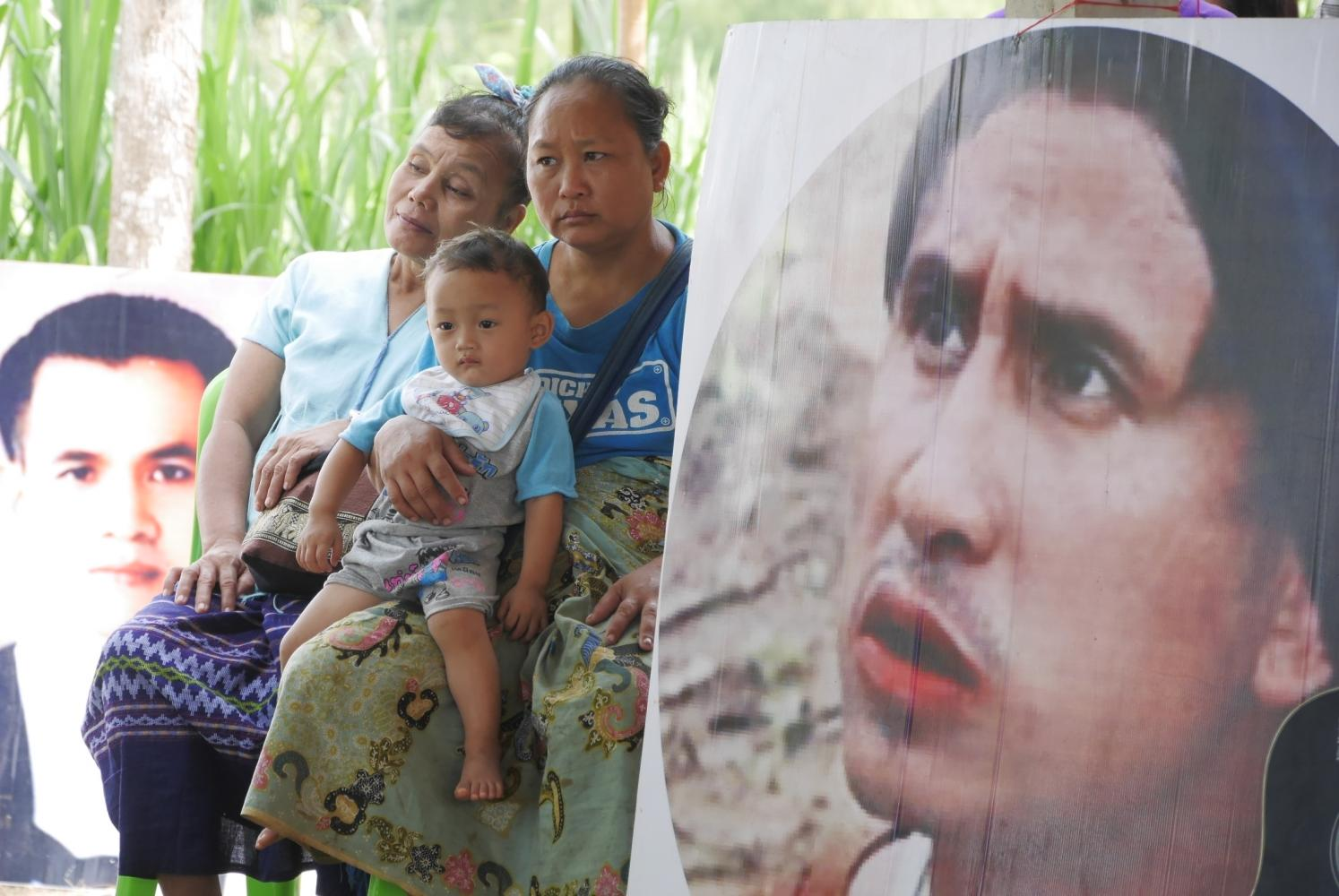 The photos of the late human rights defenders Tatkamon Ob-om (left) and Porlajee 'Billy' Rakchongcharoen (right) were exhibited during a ceremony in memory of their fight to protect the rights of indigenous Karen forest dwellers in Kaeng Krachan forest.Photo by Sanitsuda Ekachai
