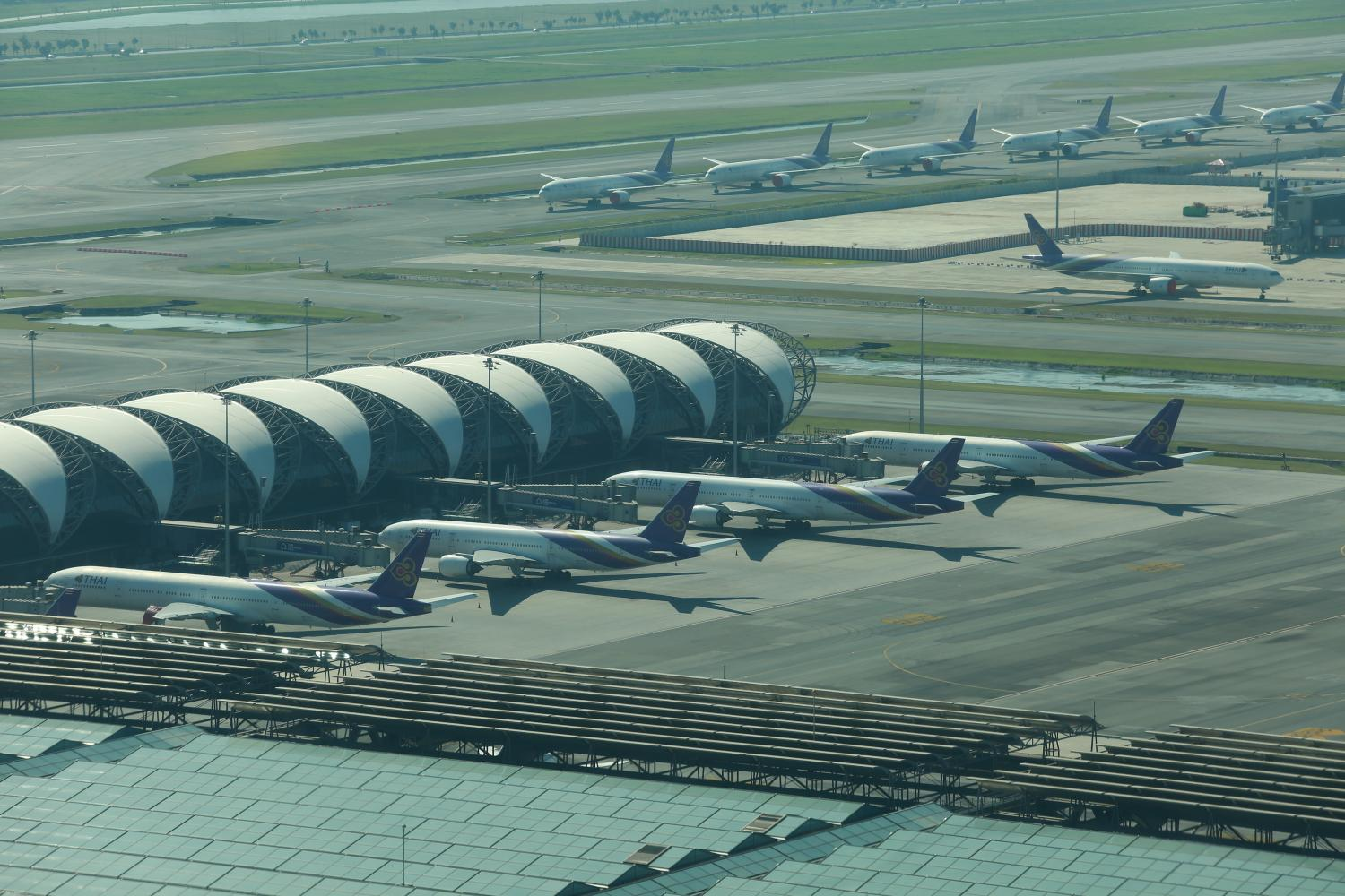 A fleet of Thai Airways airplanes are parked at Suvarnabhumi international airport. The aviation sector has been hard hit by the Covid-19 pandemic. Somchai Poomlard