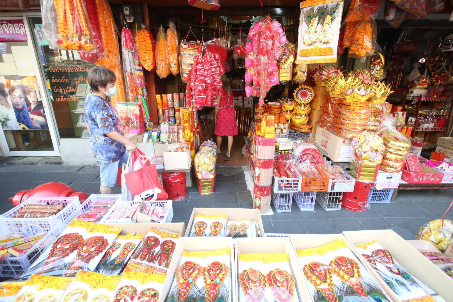 Shops at Yaowarat offering a variety of products in preparation for Chinese New Year. Pattarapong chatpattarasill