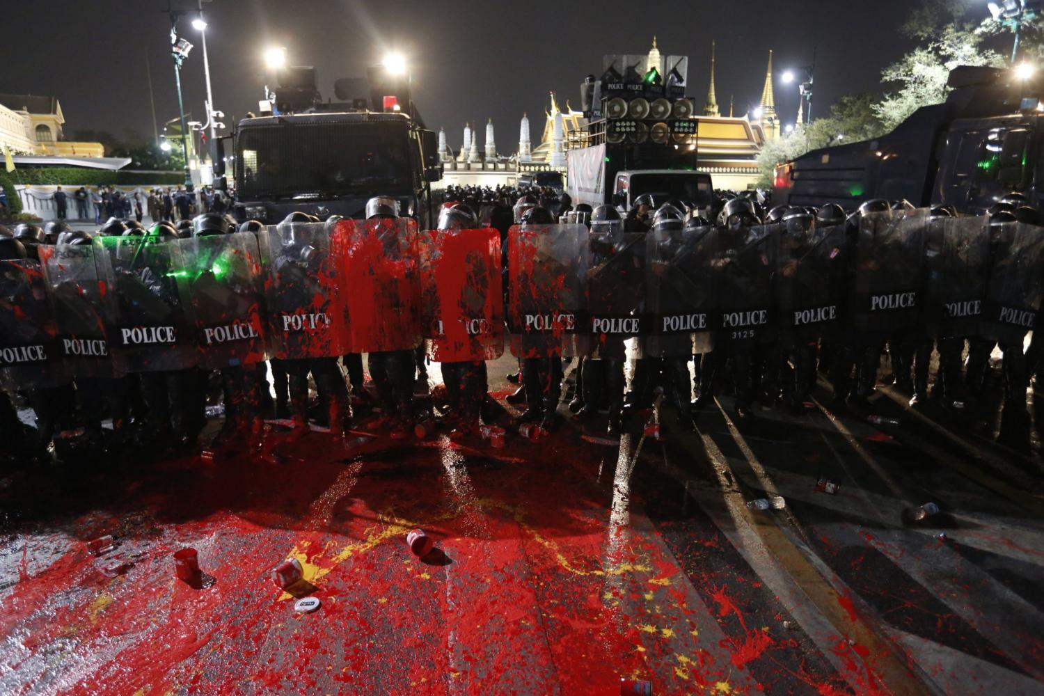 Hold the line: Anti-riot police covered in paint thrown by protesters near the Royal Palace. Police had cordoned off areas near the palace amid a demonstration by the Ratsadorn group calling for the release of four protest leaders and the amending of the lese majeste law.