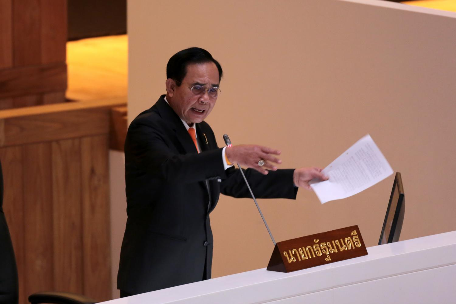 Prime Minister Prayut Chan-o-cha counters opposition criticism on the second day of the censure debate, which touched on the government's Covid record, arms procurement schemes and the closure of a goldmine in Phichit.Photos by Chanat Katanyu