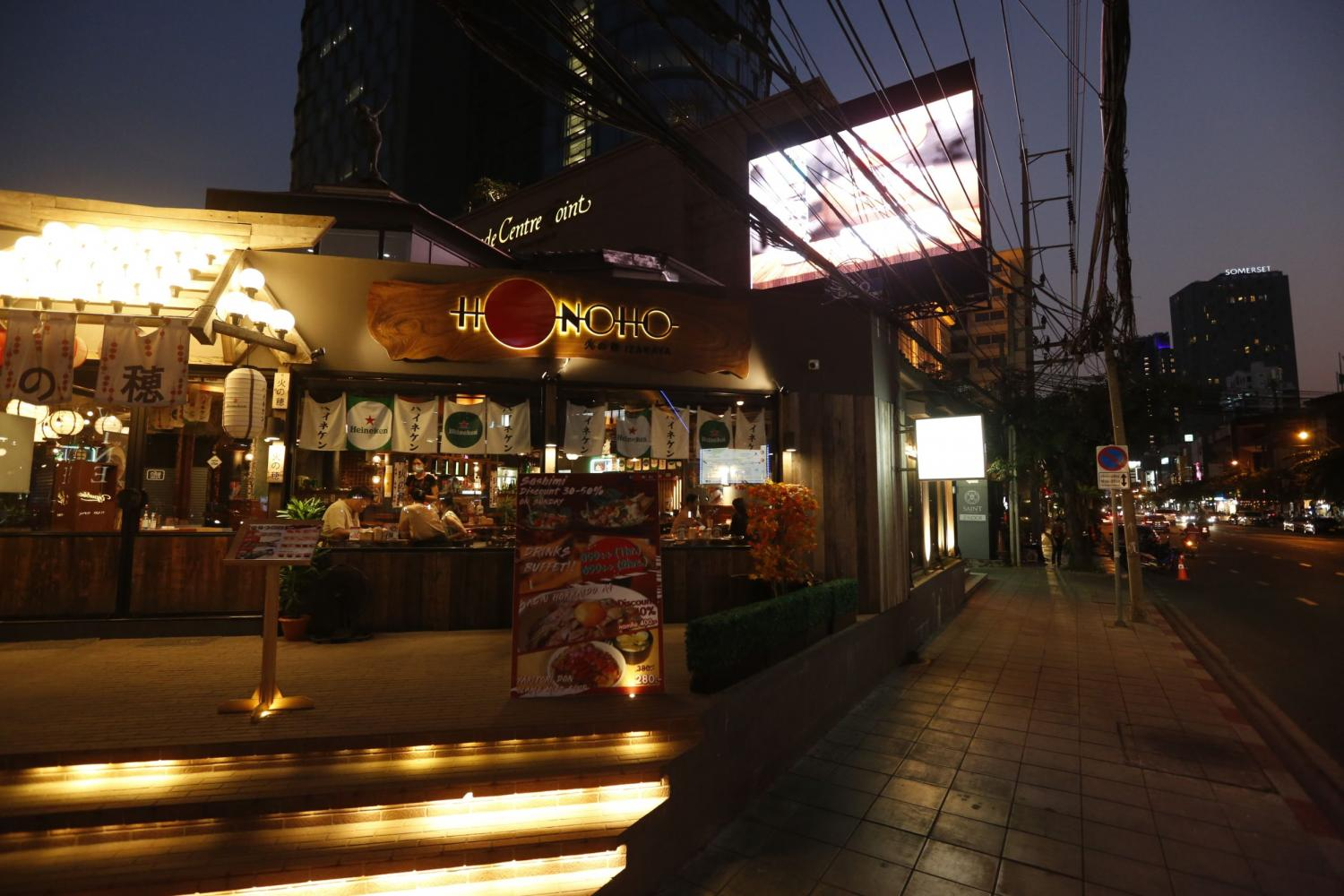 A diner at Bangkok's Sukhumvit 55, an area in Thong Lor. The alcohol ban and restrictions in restaurants was lifted on Tuesday. WICHAN CHAROENKIATPAKUL
